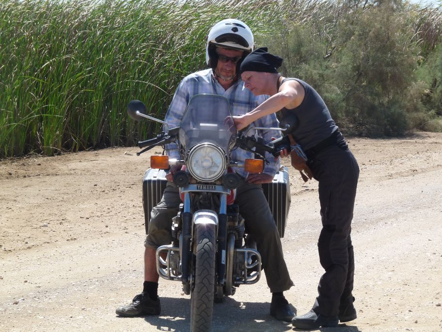 Women Who Ride: Dutch rider Elizabeth teaches a man how to ride near the Senegal border