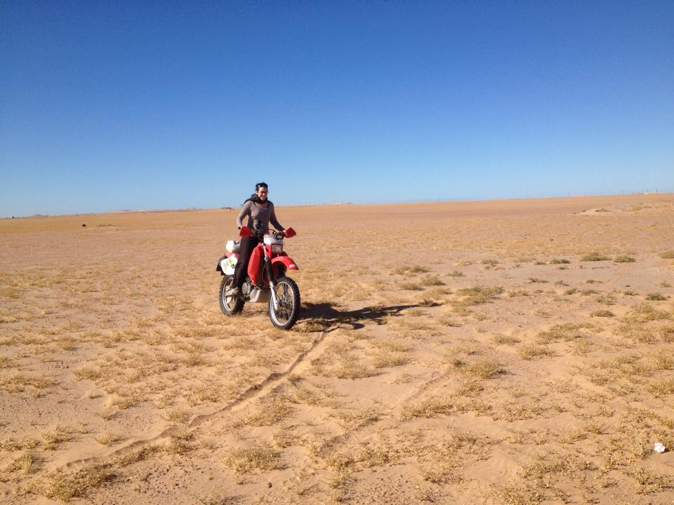 Women Who Ride: Fatima Ropero riding the Hungarian's bike in Mauritania