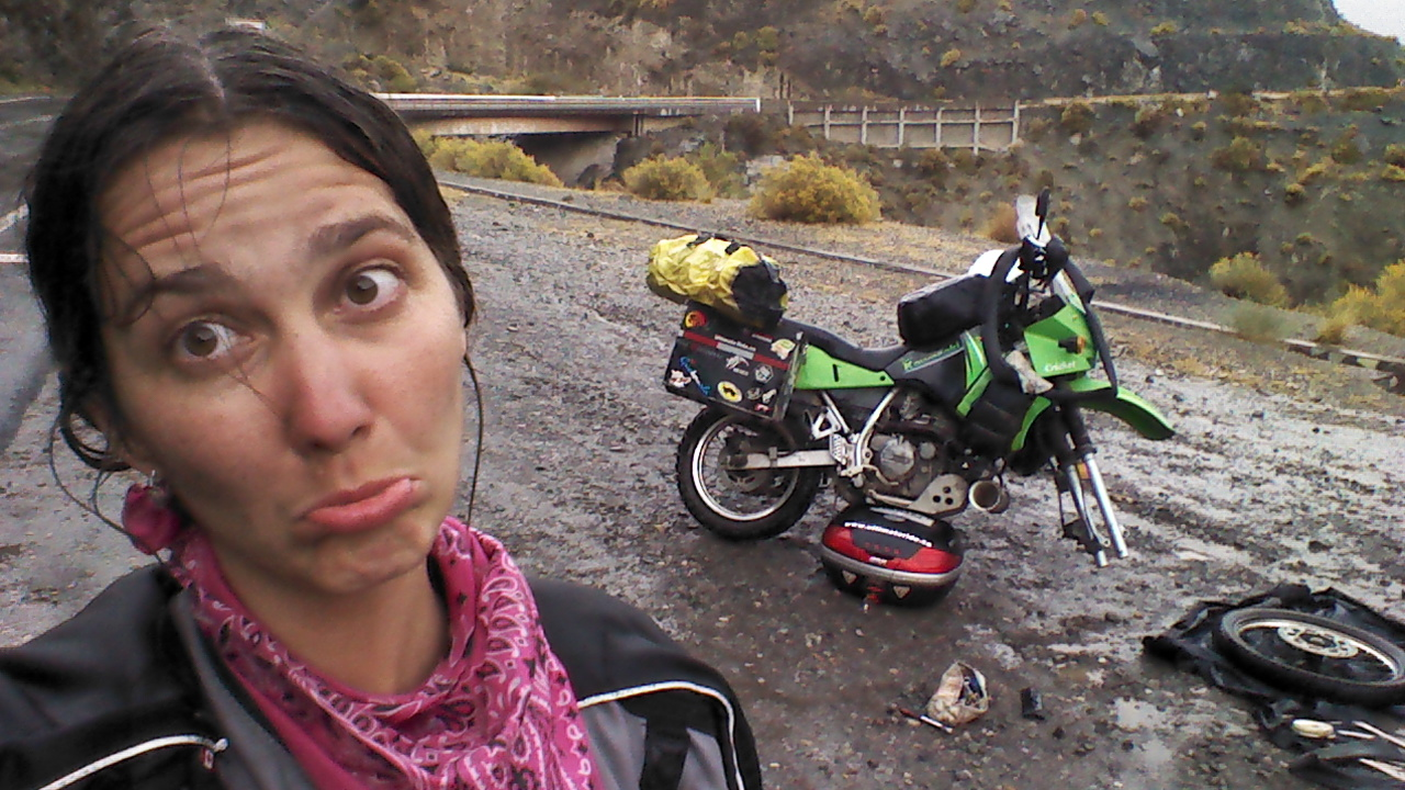 Women Who Ride: Jayne Davidson fixing a flat tire