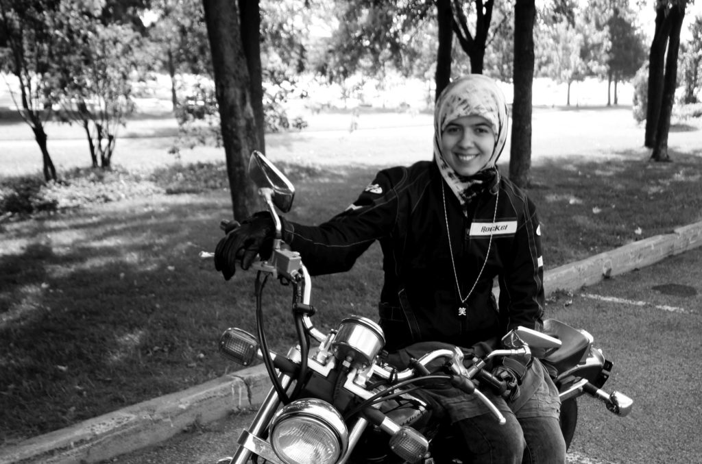 Khadijah Vakily, a Canadian Muslimah on a motorcycle, poses with her Honda Rebel