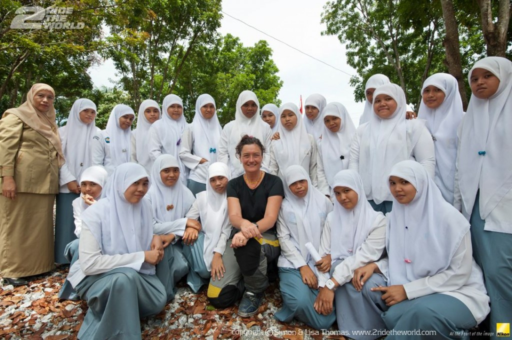 Women Who Ride: Lisa Thomas with a group of students in Sumatra