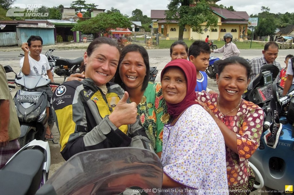 Women Who Ride: Lisa Thomas with new friends in Java