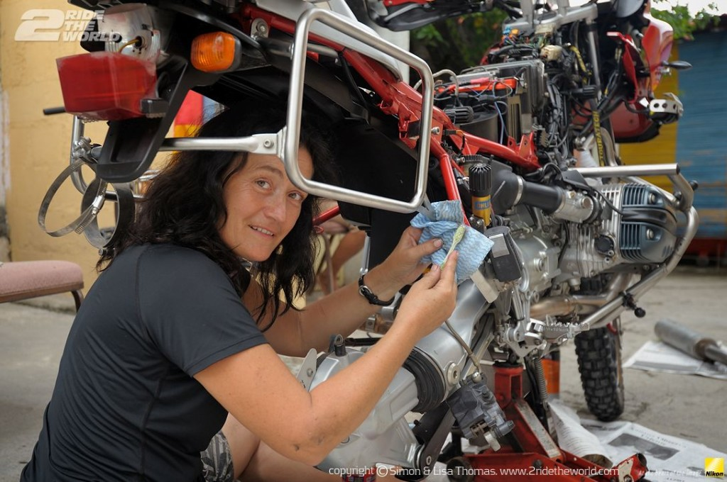 Women Who Ride: Lisa Thomas wrenching on her bike