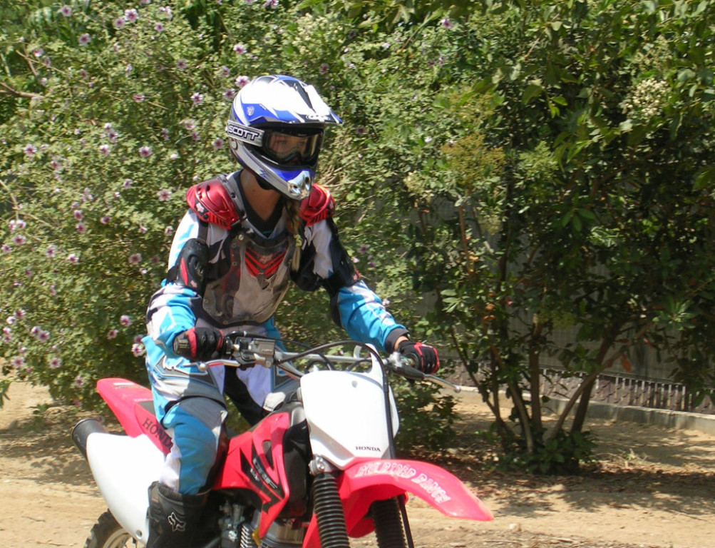 Women Who Ride: Leah Van Holten riding her dirt bike at the age of 12.