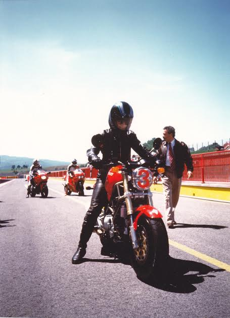 Women Who Ride: Marina Cianferoni test riding a Ducati on the Mugello circuit