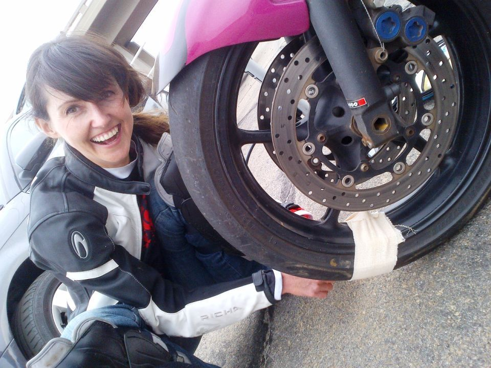 Women Who Ride: Skinny Van Schalwyck applying plasters to a cracked valve