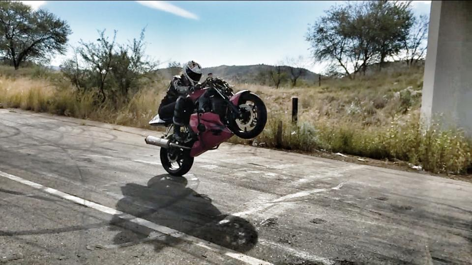 Women Who Ride: Skinny Van Schalwyck doing a wheelie