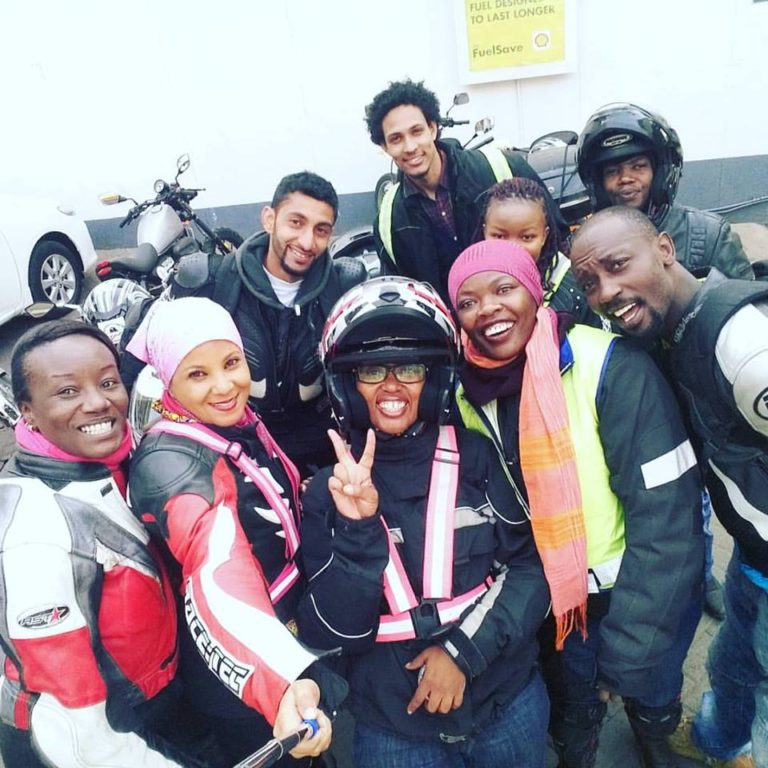 Kenyan motorcyclists posing for a selfie